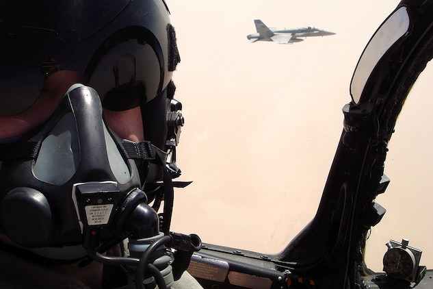 Capt. Wesley J. Deaver pilots an AV-8B Harrier beside a Kuwaiti F/A-18 during bilateral training with the Kuwait Air Force. Deaver is serving with a Harrier detachment from Marine Medium Helicopter Squadron 165 (Reinforced), the aviation combat element of the Camp Pendleton-, Calif., based 15th Marine Expeditionary Unit. The MEU is currently conducting sustainment training in Kuwait.