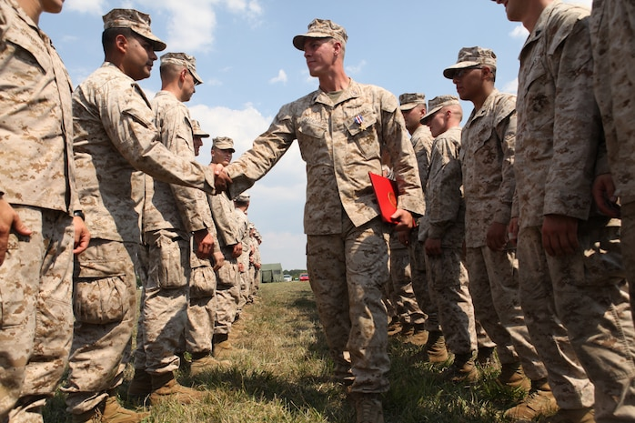 Marines assigned to the 4th Reconnaissance Battalion congratulate Staff Sgt. Alec Haralovich, after he was presented the Silver Star Medal, the nation?s third highest award for combat valor. After Haralovich was shot twice in his body armor by an insurgent, he destroyed an enemy stronghold with a rocket and led his Marines on a two-hour assault after their ambushers during an Afghanistan deployment in 2011. Haralovich is a reconnaissance Marine assigned to E Company, 4th Reconnaissance Bn., 4th Marine Division. (U.S. Marine Corps photo by Sgt. Ray Lewis)
