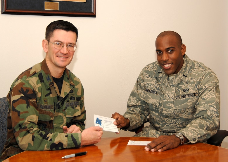 Col. Joseph Schwarz, 61st Air Base Wing commander, receives his AFAF pledge form from Lt. Travis Broadnax. This year's campaign runs until April 14 (Photo by Lou Hernandez)