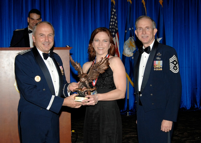 Supervisory Category Civilian of the Year was presented to Carmen Knecht. Also pictured is SMC Commander Lt. Gen.  Michael Hamel and SMC Command Chief Master Sergeant Steven Crocker. (Photo by Lou Hernandez)