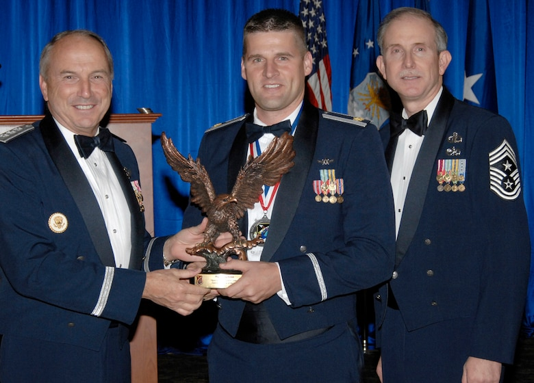Field Grade Officer of the Year was presented to Maj. Craig Dumas. Also pictured is SMC Commander Lt. Gen.  Michael Hamel and SMC Command Chief Master Sergeant Steven Crocker. (Photo by Lou Hernandez)