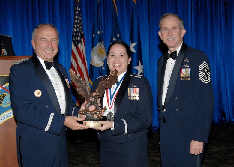 Senior Company Grade Officer of the Year was presented to Capt. Ariel Batungbacal. Also pictured is SMC Commander Lt. Gen.  Michael Hamel and SMC Command Chief Master Sergeant Steven Crocker. (Photo by Lou Hernandez)