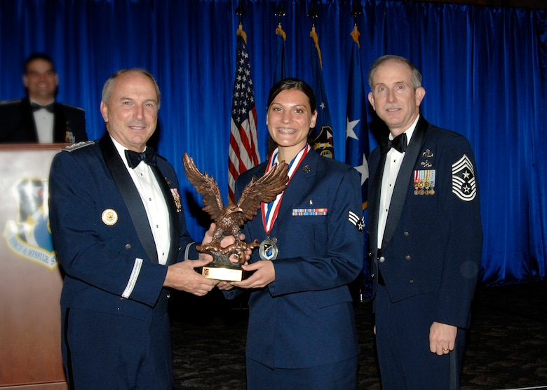 Airman of the Year was presented to Senior Airman Amanda Gladle. Also pictured is SMC Commander Lt. Gen.  Michael Hamel and SMC Command Chief Master Sergeant Steven Crocker. (Photo by Lou Hernandez)