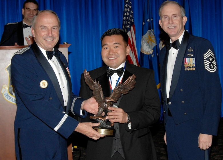Non-supervisory Category II Civilian of the Year was presented to Rayming Chang. Also pictured is SMC Commander Lt. Gen.  Michael Hamel and SMC Command Chief Master Sergeant Steven Crocker. (Photo by Lou Hernandez)