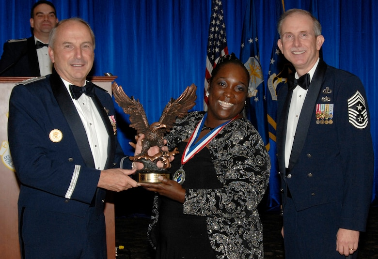 Non-supervisory Category I Civilian of the Year was presented to Rosie Manning. Also pictured is SMC Commander Lt. Gen.  Michael Hamel and SMC Command Chief Master Sergeant Steven Crocker. (Photo by Lou Hernandez)