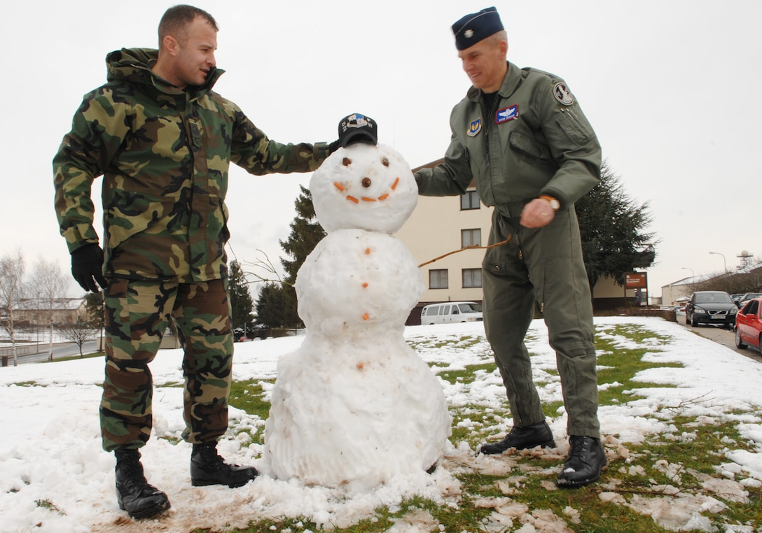 SPANGDAHLEM AIR BASE, Germany -- Lt. Col. Mark Hedman and Master Sgt. Gary Kimball, 52nd Fighter Wing Inspector General office, take a few moments at lunchtime to build a snowman outside their office March 4, 2008. Two inches of snow fell in the area today and, while not exceptional for this time of year, it was a surprise for most base residents. (U.S. Air Force photo/Senior Airman Logan Tuttle)