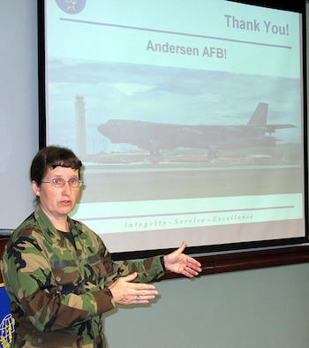 Col. Kelli Ballengee, the Pacific Air Force's bioenvironmental engineer gave the final outbrief of the 2008 external Environmental Safety Occupational Health Compliance Assessment Management Program held on Andersen Feb. 25-29. (U.S. Air Force photo by Airman 1st Class Carissa Wolff)