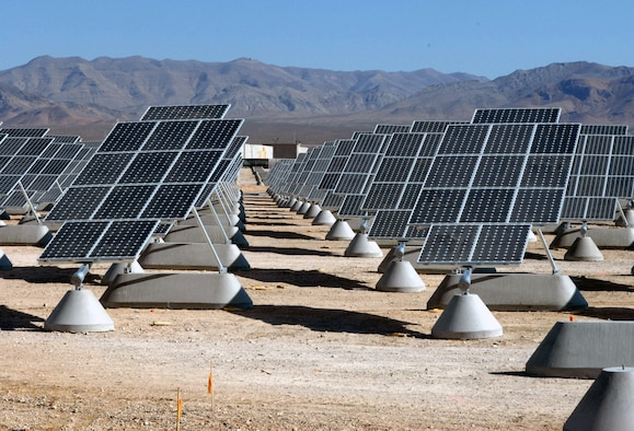 The largest photovoltaic solar power plant in the United States is becoming a reality at Nellis Air Force Base, Nev. The solar arrays can produce 15 megawatts of power for the Air Force. (U.S. Air Force photo/Paul Ridgway)