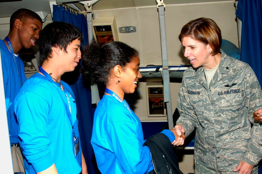 Brigadier General Lori J. Robinson, 552nd ACW Commander, coined each student individually as they exited the aircraft. Photo compliments of Visual Information.