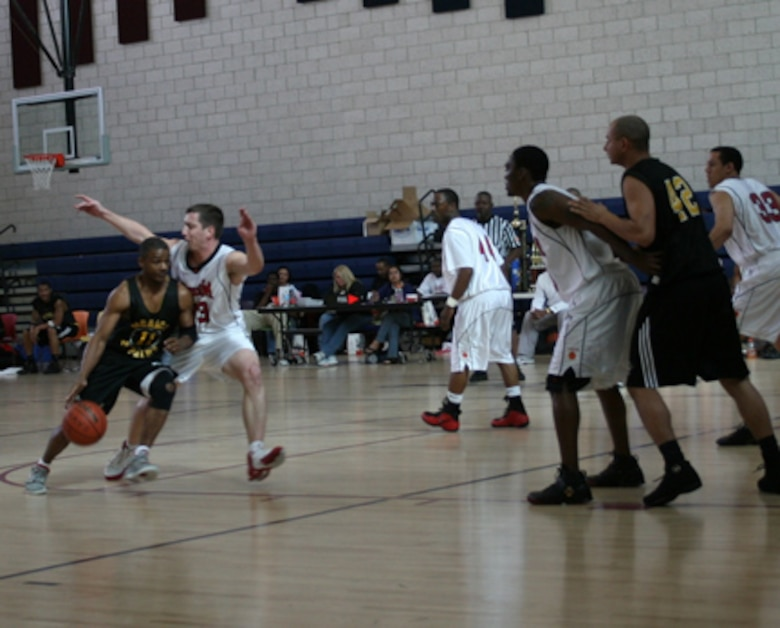 Los Angeles Air Force Base's Storm basketball team played against  Marines from Twenty Nine Palms in the Nellis Classic Tournament, Feb. 15- 18. The Storm took the championship title in their first appearance at the tournament.