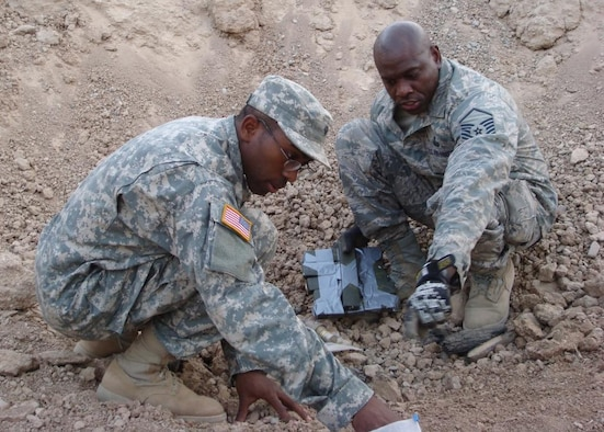Master Sgt. George Price, Jr., right, responds after an insurgent 122m projectile was fired into Forward Operating Base McHenry in the Hawijah District of Iraq in September 2007. Helping him is an Army specialist assigned to the 25th Infantry Division. During his last two deployments to Iraq, Sergeant Price has earned the Air Force Combat Action Medal and two Army Combat Action Badges (meaning he was directly engaged by the enemy and returned fire) along with two Bronze Stars for heroism in combat. He was recently named the Senior NCO of the Year for 14th Air Force.