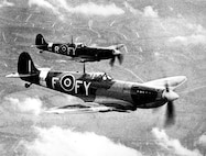 Two British Spitfires in formation.