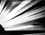 B-17 vapor trails create a beautiful site as they join together in the morning sky for a long range mission to the continent.