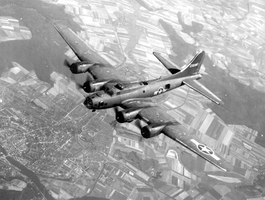 B-17 in flight with no tail markings to indicate unit.