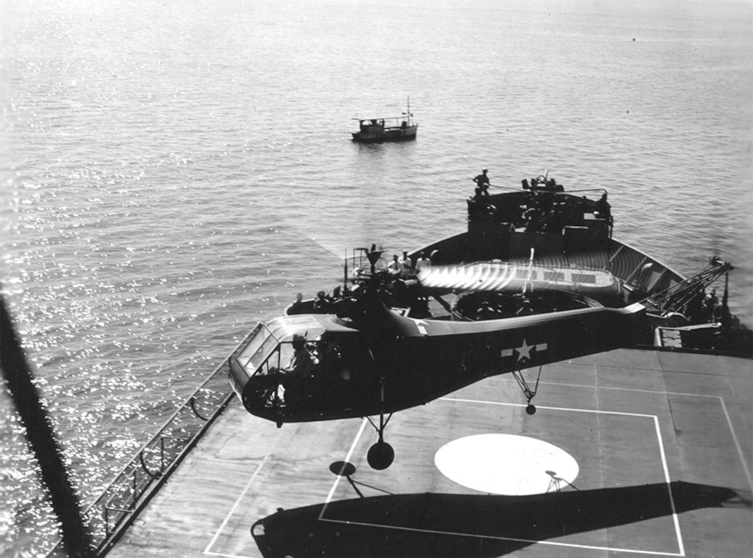 A second photo of the helicopter departing the ship.