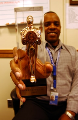 ANDREWS AIR FORCE BASE, Md. -- Master Sgt. Derrick Wright, 459th Aeromedical Evacuation Squadron training manager, holds up his Golden Roger award in the public affairs office Jan. 20. (U.S. Air Force photo/Staff Sgt. Amaani Lyle)