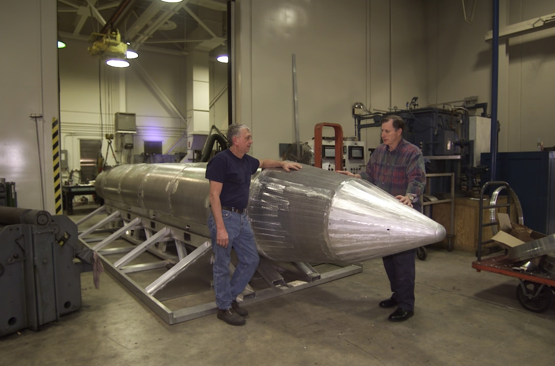 EGLIN AIR FORCE BASE, Fla. -- Al Weimorts, the creator of the GBU-43/B Massive Ordnance Air Blast bomb, left, and Joseph Fellenz, lead model maker look over the prototype before it was painted and tested. (Courtesy photo)
