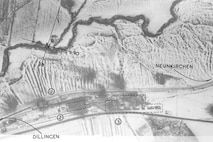"""Ninth AF 2nd Phase Interpretation Report US10/D 659 LOCALITY:  LEBACH SUPPLY DEPOT & SIDINGS  SORTIE:  US 15/3993  DATE: 19 Jan  45  PERIOD UNDER REVIEW:  This report covers all damage to the target as it existed at 1530A hours on 19.1.45  COVER:  The target (US10/T 441) is covered on prints of good quality.  STATEMENT:  One small warehouse type building destroyed.  One large warehouse type building destroyed.  Two large warehouse type buildings and one small building destroyed.  Two warehouse buildings severely damaged and others within the area blocked and at least 20 goods wagons have been damaged or destroyed.  A single crater blocks a siding at (Q/100903).  Through rail traffic is possible from DILLINGEN to NEUNKIRCHIN.  ACTIVITY:  12 /T are visible in the vicinity;  3 marked with the """"Red Cross"""" are in motion.  Approximately 240 mixed goods wagons, flats, and 4 engines, one of which is in steam, are present.  Some of the flats near the supply depot may be loaded with M/T. Considerable track activity is seen throughout the area.  20th P. I. D. at Hq. 10th P. G."""
