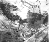 """Ninth AF 2nd Phase Interpretation Report US10/D 895 LOCALITY:  VON RUNDSTEDT'S HEADQUARTERS  SORTIE:  US 12/4307 – 5001-14  TOT: 20 Mar 45, 1010A   PERIOD UNDER REVIEW:  This report covers all damage to date.  COVER:  The target is covered on prints of good quality.    STATEMENT:  Ground sources have reported this castle to be Von Rundstedt's Headquarters.  The east wing of the castle is completely destroyed and the entire top floor is demolished or gutted by fire.  The small building just south of the """"L"""" shaped building is destroyed and the top floor of the """"L"""" shaped building is severely damaged.  This building is completely destroyed.  At least  11 dwellings are destroyed and 7 others severely damaged.  ACTIVITY:  Evidence of evacuation of the premises is noted as stacks of supplies are in the yard and several M/T are present.  The large underground buildings to the NW remain undamaged.  20th P. I. D. at Hq. 10th P.G."""