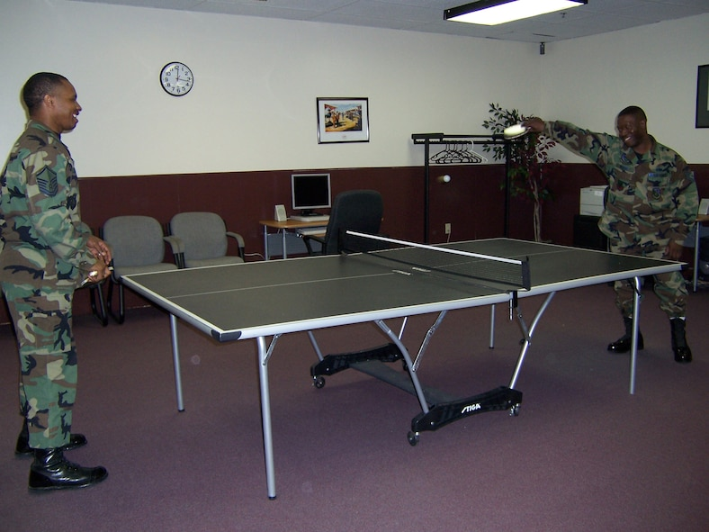 CANNON AIR FORCE BASE, N.M. - Master Sgt. Darrell Harris (left), 27th Special Operations Mission Support Squadron, and Tech. Sgt. Jarvis Moore, 712th Maintenance Squadron (provisional), play a game of pingpong while catching up on old times. The two sergeants were in the same flight at BMT and Cannon is the first duty station both have been at at the same time in more than 20 years. (U.S. Air Force photo by Airman 1st Class Elliott Sprehe)