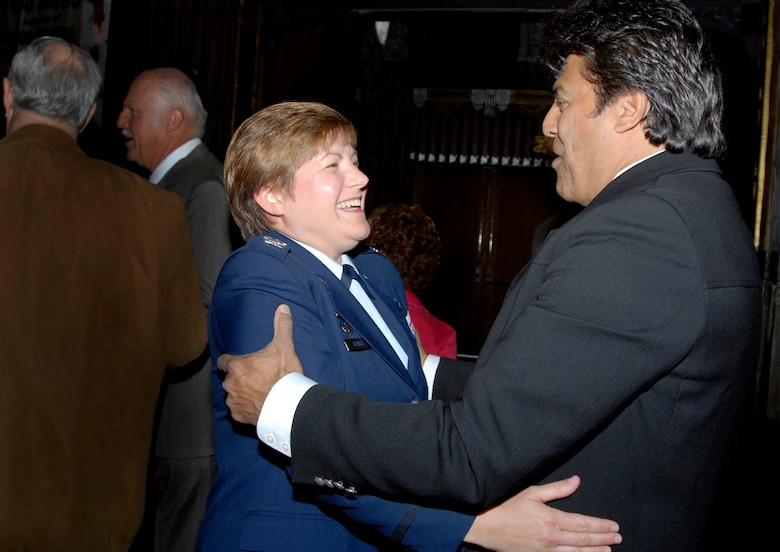 Col Nannette Benitez, 61st Mission Support Group commander, met actor Eric Estrada at a tribute to Johnny Grant held at the Pantages Theatre in Hollywood, March 6.  Grant passed away Jan. 9 at the age of 84.  His friends and Hollywood stars reminisced about his life as the Honorary Mayor of Hollywood, a retired major general in the California State Military Reserve, and regular USO entertainer and emcee. A number of Airmen from Los Angeles AFB help send Grant off on his last USO tour in December 2007. (Photo by Joe Juarez)