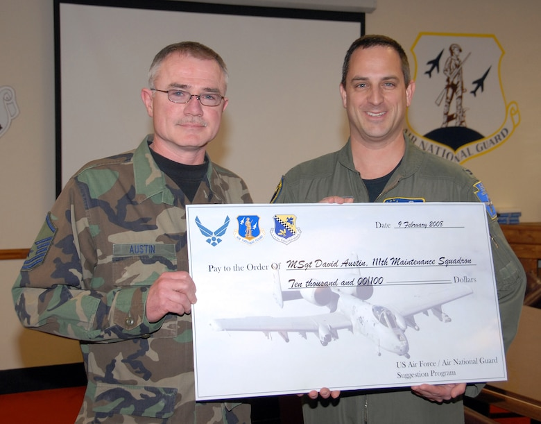 Col. Paul W. Comtois, 111th Fighter Wing commander, presents Master Sgt. David R. Austin, 111th Maintenance Squadron, a $10,000 check from the NGB Suggestion Program Feb. 10 at Willow Grove Air Reserve Station, Pa.  Austin developed an A-10 fuel systems tester that saved the Air Force almost $600,000.