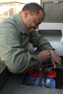 ANDREWS AIR FORCE BASE, Md. -- Tech. Sgt. Walter King, 459th Maintenance Squadron aerospace ground equipment specialist, troubleshoots a battery fault on a generator. (U.S. Air Force photo/Tech. Sgt. Eric Sharman)
