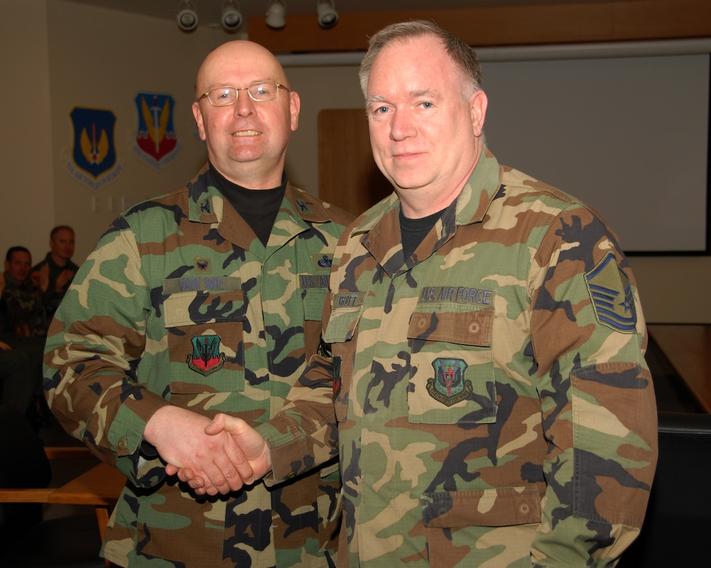 Master Sergeant Donald R. Croft of the 174th Fighter Wing, Hancock Field, Syracuse, New York is presented an award for 30 years of military service by Colonel Harvey M. Van Wie, Jr., 174th Support Group Commander on 13 March 2008, during a pre Unit Training Assembly meeting at the 174th Fighter Wing, Headquarters Conference room.  (New York Air National Guard Photo by Staff Sergeant Ben A. Stafford, 174th Public Affairs Office) (Released)