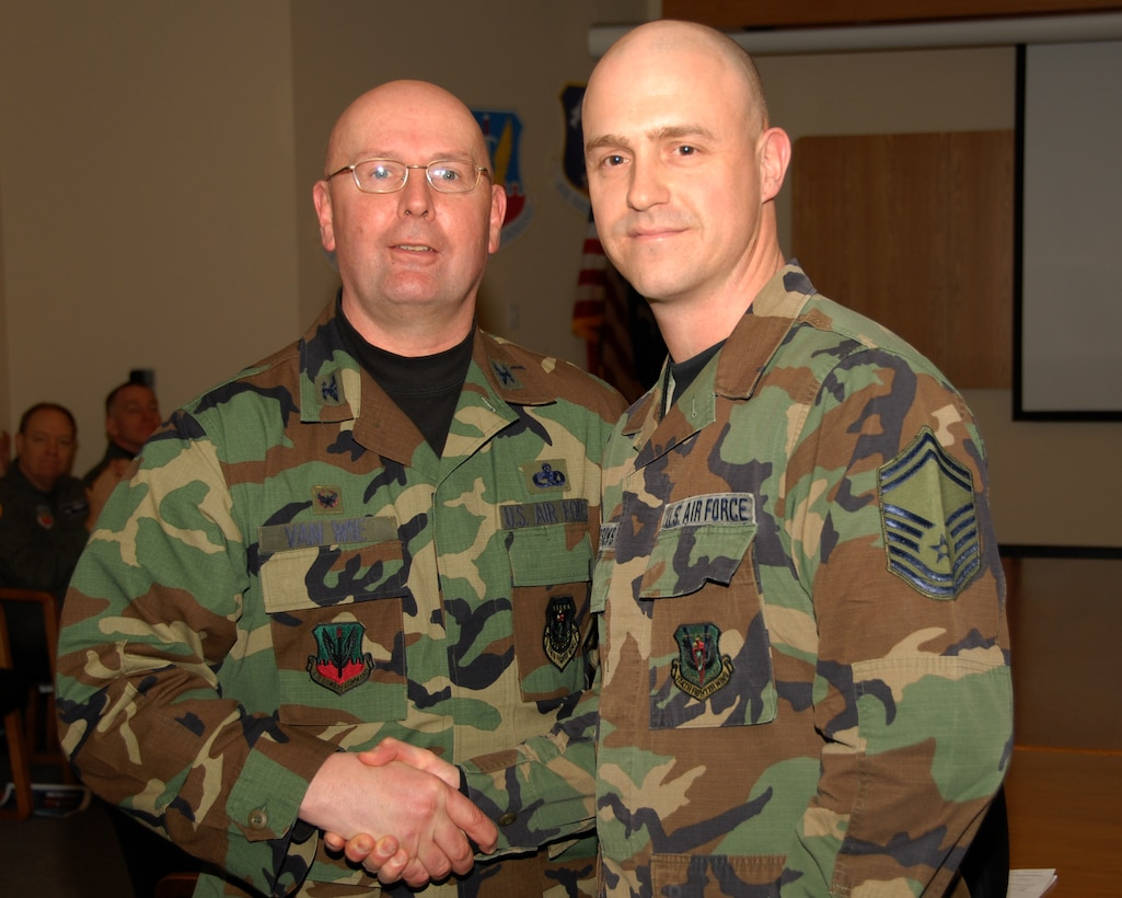 Senior Master Sergeant Jerry D. Burrows of the 174th Fighter Wing, Hancock Field, Syracuse, New York is presented an award for 20 years of military service by Colonel Harvey M. Van Wie, Jr., 174th Support Group Commander on 13 March 2008, during a pre Unit Training Assembly meeting at the 174th Fighter Wing, Headquarters Conference room.  (New York Air National Guard Photo by Staff Sergeant Ben A. Stafford, 174th Public Affairs Office) (Released)