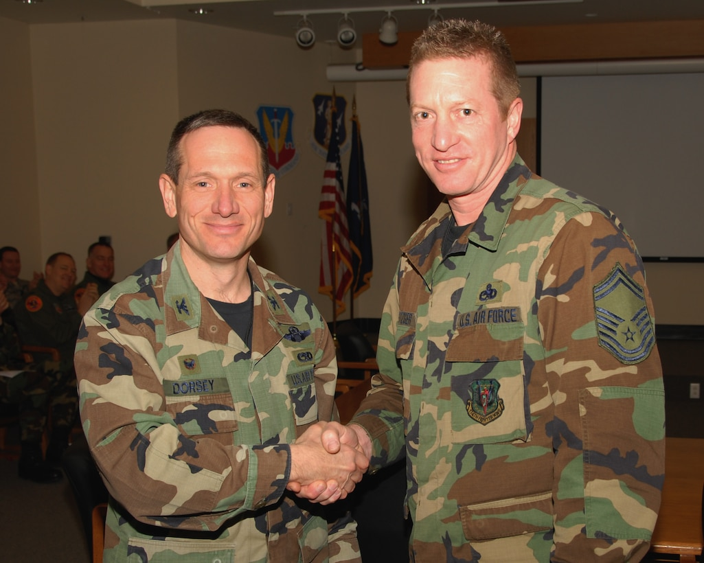 Senior Master Sergeant Curtis Metzger of the 174th Fighter Wing, Hancock Field, Syracuse, New York is presented an award for 30 years of military service by Colonel Charles Dorsey, 174th Maintenance Group Commander on 13 March 2008, during a pre Unit Training Assembly meeting at the 174th Fighter Wing, Headquarters Conference room.  (New York Air National Guard Photo by Staff Sergeant Ben A. Stafford, 174th Public Affairs Office) (Released)