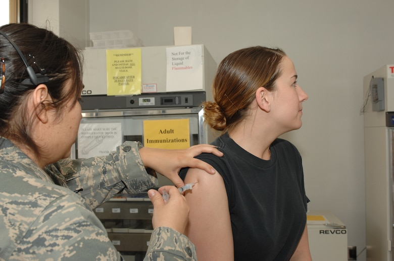 DYESS AIR FORCE BASE, Texas -- Airman 1st Class Jennifer Romig, 7th BW/PA, receives a vaccination from Staff Sgt Melinda Grisby, Alllery/Immunization technician, at the 7th Medical Group, March 10. Dyess Airman must stay current on their vaccination to maintain deployment readiness. (U.S Air Force photo by Senior Airman Courtney Richardson)