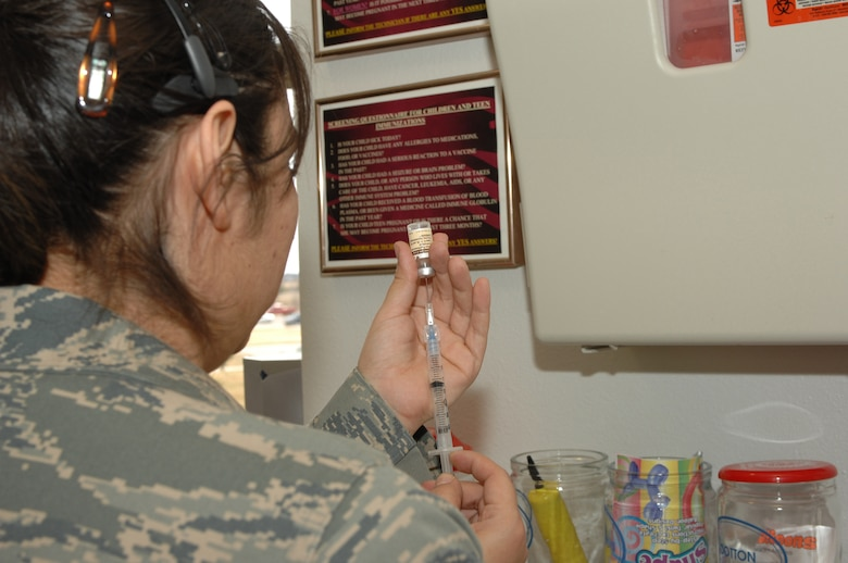 DYESS AIR FORCE BASE, Texas -- Staff Sgt. Melinda Grisby, Allergy/Immunization technician, draws up medication to vaccinate at the 7th Medical Group March 10. SSgt Grisby can give between 20 to 80 shots a day depending on deployments. (U.S. Air Force photo by Senior Airman Courtney Richardson)
