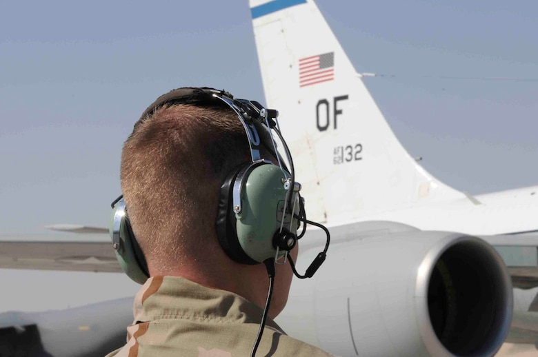 Senior Airman Joshua Sexton, 379th Expeditionary Aircraft Maintenance Squadron, communicates with aircraft pilot at a Southwest Asia air base March 12. Airman Sexton is the eyes and ears for the outside of the aircraft while pilots perform pre-flight checks. He is from Springfield, IL deployed from Offutt Air Force Base, NE. (U.S. Air Force photo/Tech. Sgt. Johnny L. Saldivar)
