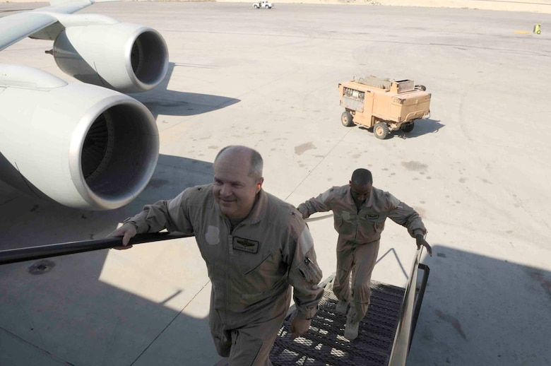Brig. Gen. Charlie Lyon, 379th Air Expeditionary Wing commander, boards an aircraft March 12 at a Southwest Asia air base. The general and Capt Kareem Haskett, 379th Expeditionary Reconnaissance Squadron will pilot aircraft that has logged 50,000 hours flight time. (U.S. Air Force photo/Tech. Sgt. Johnny L. Saldivar)