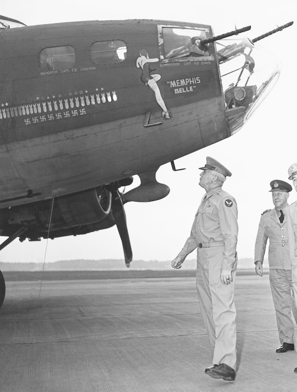"Gen. Hap Arnold, commander of the U.S. Army Air Forces, examining the ""Mempis Belle"" after it returned to the United States. (U.S. Air Force photo)"