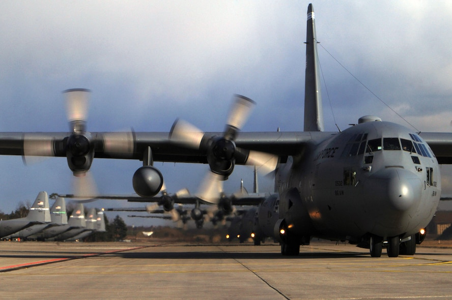A line of C-130 Hercules aircraft prepare to depart Ramstein Air Base, Germany, March 5 for mass tactical training. The training allows 86th Airlift Wing aircrews to maintain proficiency in large formation flying and airdrop operations. (U.S. Air Force photo/Senior Airman Melissa Sheffield)