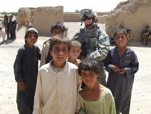 "Staff Sgt. Trisha Scheu with some local children during her recent deployment to Afghanistan on an ""in lieu of"" assignment augmenting Army troops. (U.S. Air Force photo courtesy of Staff Sgt. Trisha Scheu"