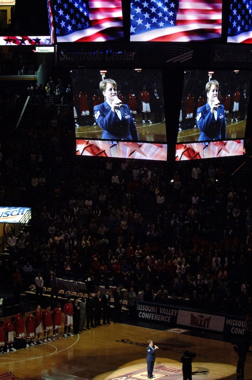 Tech. Sgt. Kristine Keyser, a readiness NCO from the 375th Mission Support Squadron's Airman and Family Readiness Center, sings the national anthem prior to the college basketball semifinals of the Missouri Valley Tournament between the Illinois State Redbirds and the Northern Iowa Panthers held at Scottrade Center, in St. Louis.