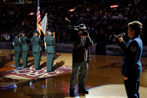 Tech. Sgt. Kristine Keyser, a readiness NCO from the 375th Mission Support Squadron's Airman and Family Readiness Center, sings the national anthem as the Illinois State University ROTC Honor Guard post the colors prior to the college basketball semifinals of the Missouri Valley Tournament between the Drake Bulldogs and the Creighton Bluejays held at Scottrade Center, in St. Louis.  