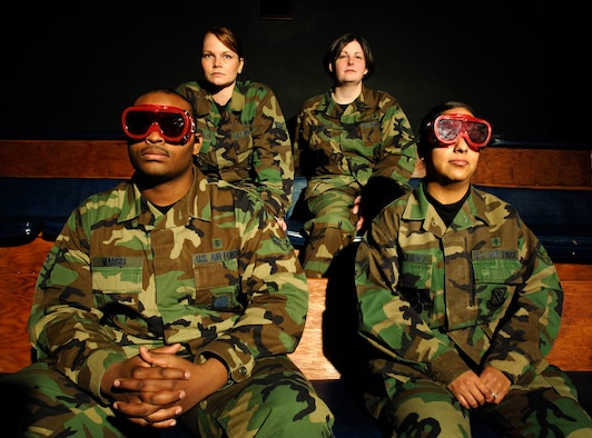 FAIRCHILD AIR FORCE BASE, Wash. –Airman 1st Class Dwayne Marsh and Airman 1st Class Miriam Hernandez, 92nd Aerospace Medicine Squadron aerospace physiology technicians, use goggles to dark adapt during night vision training on March.12. Airman 1st Class Bethany Whiteley and Airman 1st Class Mary Bowie, who are not wearing goggles, experience limited vision in a darkened environment as a result of exposure to bright lights. (U.S. Air Force photo/Staff Sgt. JT May III)