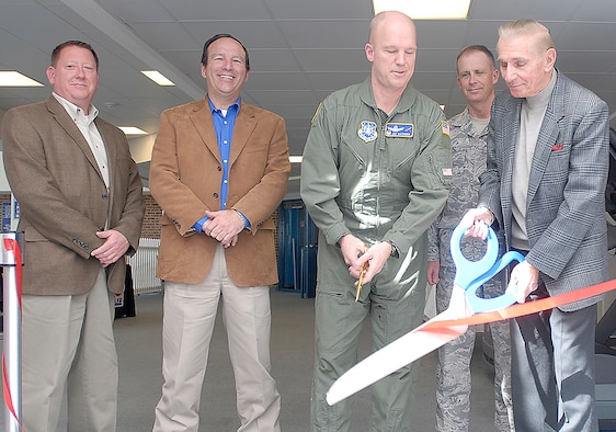 Col. Jay Raymond, 21st Space Wing commander (center), together with retired Air Force Gen. Don Kutyna, cut the ribbon to the grand re-opening of the Peterson Aquatics Center March 14. Following $2.8 million in upgrades, the pool is now covered by a new, durable roof structure, a new hot tub, slip-proof flooring and a new, $85,000 pool liner. (U.S. Air Force photo/Dennis Howk)