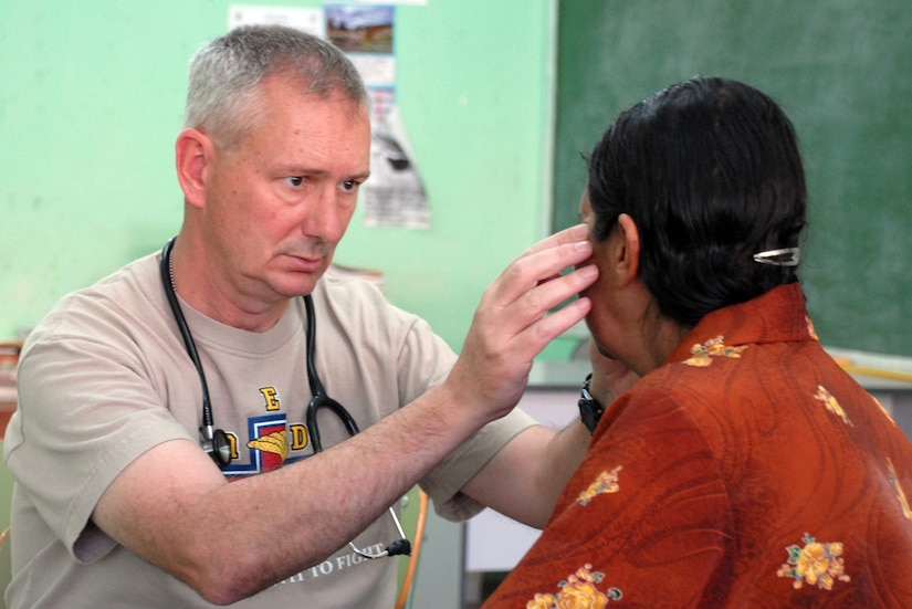 SOTO CANO AIR BASE, Honduras--Army Col. Mike Sigmon, JTF-Bravo MEDEL commander, examines a patient during the Medical Readiness Training Exercise March 10 in Morolica, Honduras. Managed by SOUTHCOM since 1989, the MEDRETE program is one of the premier engagement efforts in the region, giving U.S. military health care personnel the opportunity to have a positive impact on thousands of people who may not have had any medical care in years. (U.S. Air Force photo by Tech. Sgt. William Farrow)