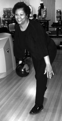 Rhonda Wright, logistics management specialist with the 848th Combat Sustainment Group, bowled an 823 series at the Tinker Bowling Center Feb. 28.  She bowled a 246-277-300 for an 823 tying the center's high series score in history (Men 823/Women 781).  Ms. Wright has received many accolades in the sport with four sanctioned 300 games, a 299 game, numerous 700 series, numerous 11 in roll plaques and the lifetime achievement award from WIBC for city high average (217) in 2006.  (Air Force photo by Kimberly Woodruff)