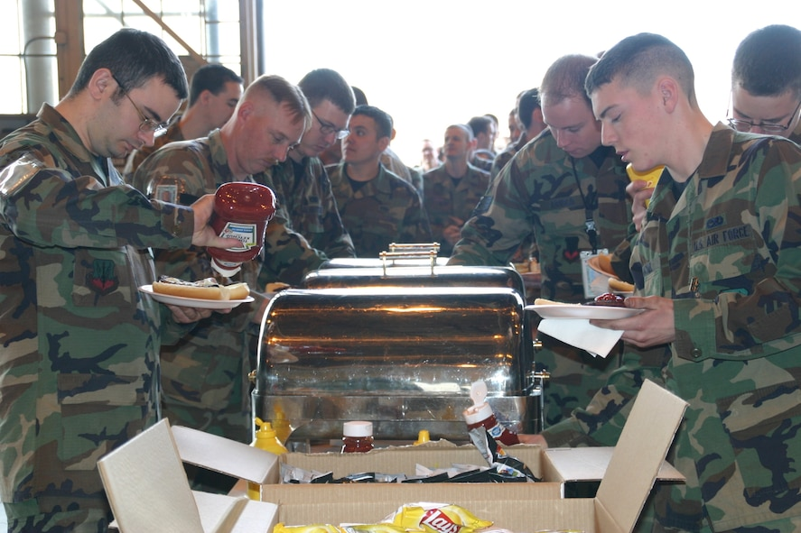 Airmen of the 552nd Maintenance Group enjoy a burger burn in celebration of their successful completion of the ACC LSET inspection Feb. 25-29.
