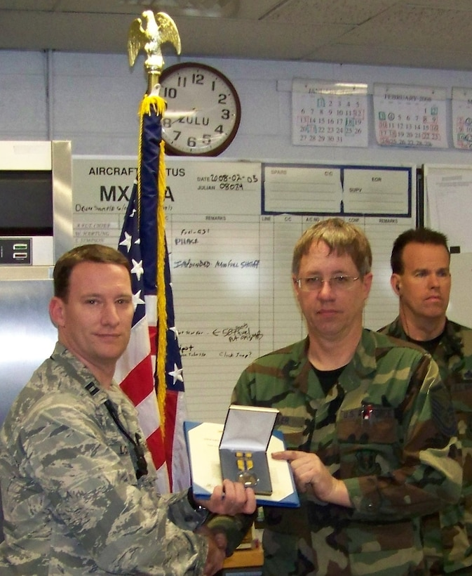 F-16 Crewchief Master Sergeant Cady Kepler receives the Air Force Commendation Medal from Capt Nick Lotito, AMXS OIC.
