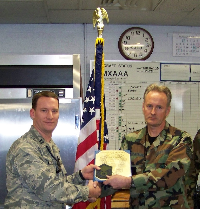 F-16 Crewchief and newly promoted Master Sergeant Fitzpatrick receives his MSgt Stripes from Capt Nick Lotito, AMXS OIC.