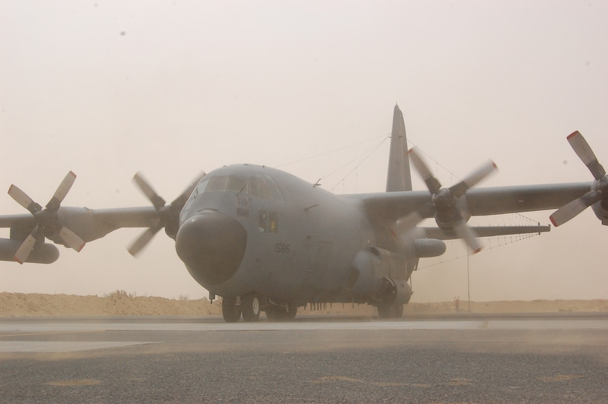 SOUTHWEST ASIA – The 4,591 prop shaft horsepower of two Allison T56-A-15 turboprops kicks up dust and pebbles from the parking ramp during an EC-130H Compass Call reverse engine thrust as it backed into position at an air base in the Persian Gulf Region March 18, 2008. Aircraft tail number 1586 is deployed from the 55th Electronic Combat Group out of Davis-Monthan Air Force Base, Ariz., and was flown on the 43rd Expeditionary Electronic Combat Squadron's 2,276th combat sortie marking the Arizona-based unit's fourth consecutive year deployed supporting the Global War on Terror. (Air Force photo/Tech. Sgt. Michael O'Connor)