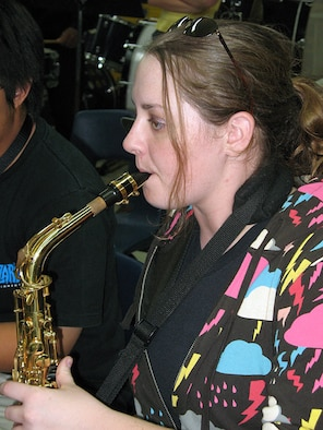 Senior Airman Rebecca Cook, a boundary protection specialist with the 36th Comunications Squadron plays the 1st Alto Saxophone with the Guam Territorial Band Mar. 20 during a scheduled practice session. SrA Cook has been playing the 1st Alto Saxophone since the age of eight.  (U.S. Air Force photo by Airman 1st Class Carissa Wolff)