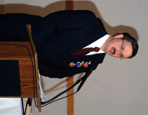 OSI Special Agent Jac Christiansen speaks at his award ceremony after receiving a Bronze Star, a Purple Heart and a Combat Action Medal for his services during his 2007 deployment in support of Operation Iraqi Freedom.