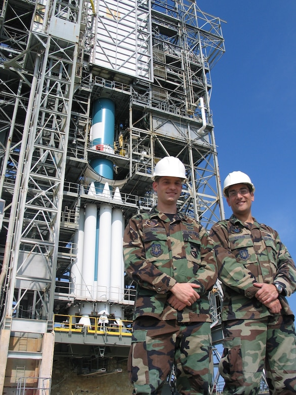 1st. Lt. Josh Hall (left) of the 1st Space Launch Squadron and Capt. Bill Bakker of the 45th Launch Support Squadron with the Delta II booster they helped launch March 15 from Complex 17A at Cape Canaveral Air Force Station.